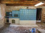 Kachlový sporák a kamna vesnického typu